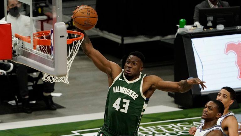 Milwaukee Bucks' Thanasis Antetokounmpo dunks during the second half of an NBA basketball game against the Sacramento Kings