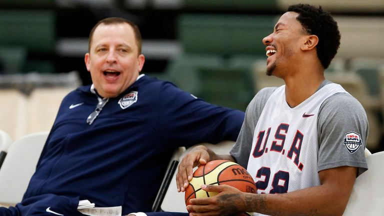 Assistant Coach Tom Thibodeau and Derrick Rose speak during a practice of the men's U.S. National basketball team in 2014