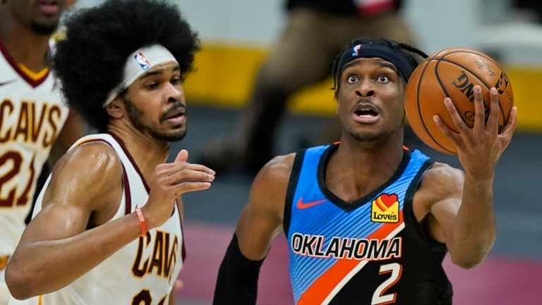Oklahoma City Thunder's Shai Gilgeous-Alexander drives to the basket against Cleveland Cavaliers' Jarrett Allen