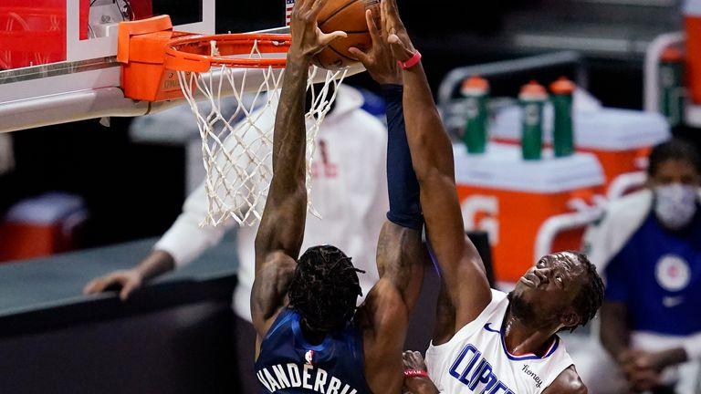 Minnesota Timberwolves forward Jarred Vanderbilt goes up for a shot against Los Angeles Clippers guard Reggie Jackson