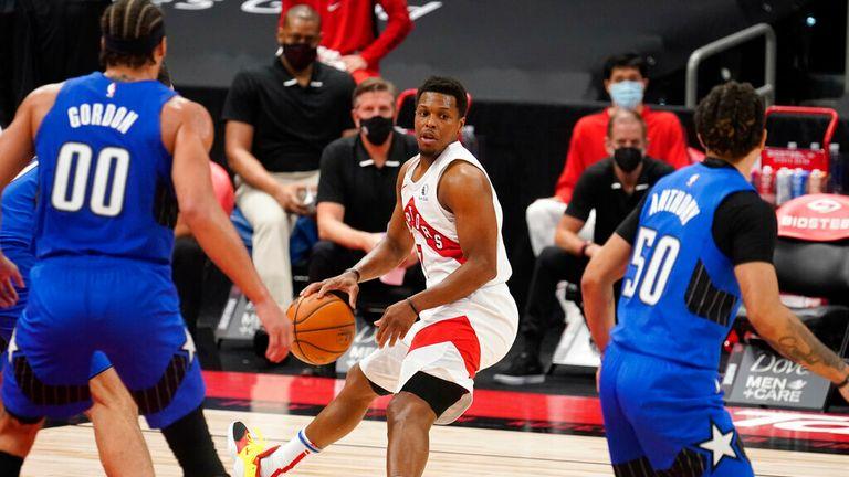 AP - Toronto Raptors guard Kyle Lowry (7) looks to pass against the Orlando Magic