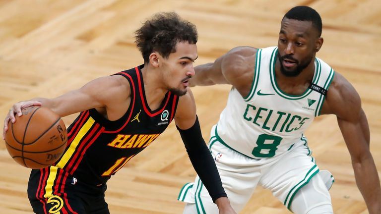 Atlanta Hawks' Trae Young drives past Boston Celtics' Kemba Walker