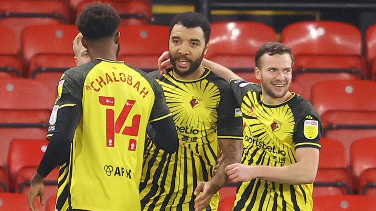 Troy Deeney is congratulated after scoring from the penalty spot to put Watford 1-0 up against QPR