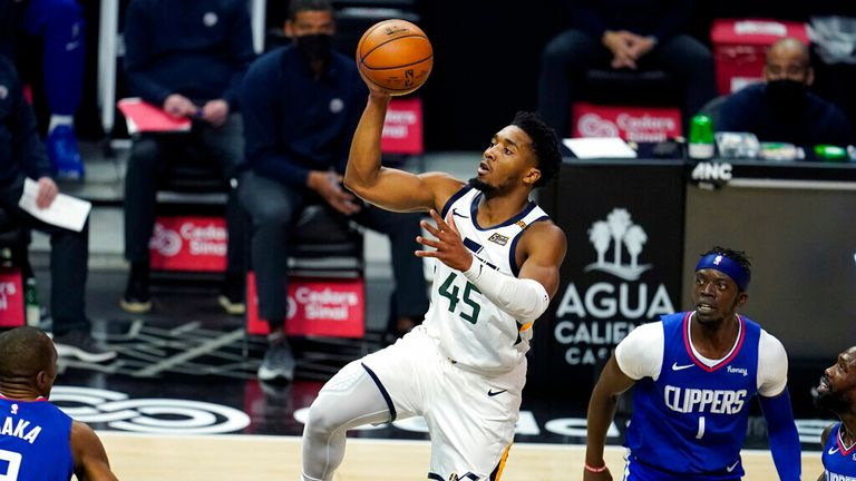 AP - Utah Jazz guard Donovan Mitchell (45) shoots past Los Angeles Clippers guard Reggie Jackson (1)