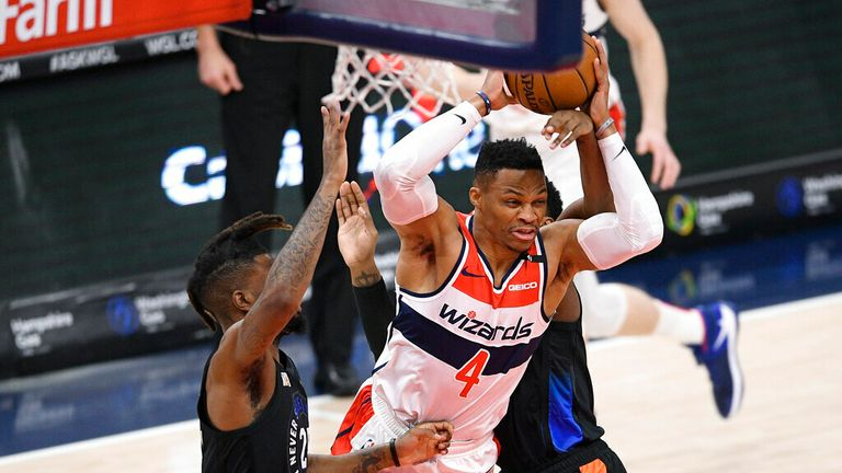 AP - Washington Wizards guard Russell Westbrook (4) tries to get past New York Knicks forward Reggie Bullock, left, and guard RJ Barrett
