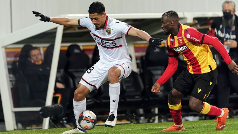 William Saliba of OGC Nice competes for the ball with Ignatius Ganago of RC Lens
