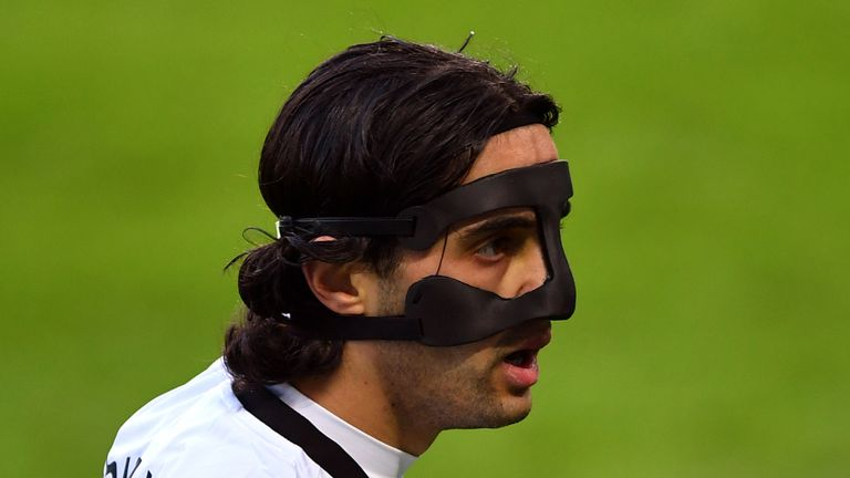 Swansea City's Yan Dhanda sports a protective mask during the Emirates FA Cup fourth round match at the Liberty Stadium, Swansea. Picture date: Saturday January 23, 2021