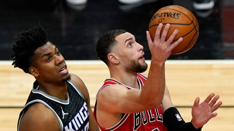 Chicago Bulls guard Zach LaVine drives to the basket past Sacramento Kings center Hassan Whiteside