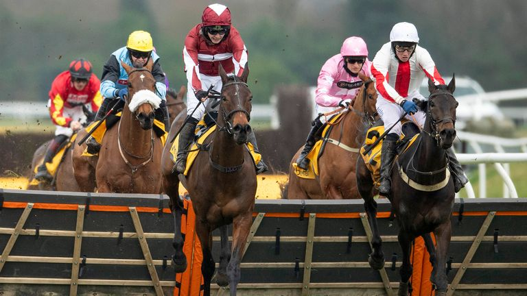 NEWBURY, ENGLAND - FEBRUARY 21: Jonjo O'Neill riding Soaring Glory (C, maroon) clear the last to win The Betfair Hurdle at Newbury Racecourse on February 21, 2021 in Newbury, England. Due to the coronavirus pandemic, owners along with the paying public will not be allowed to attend the meeting. (Photo by Alan Crowhurst/Getty Images)