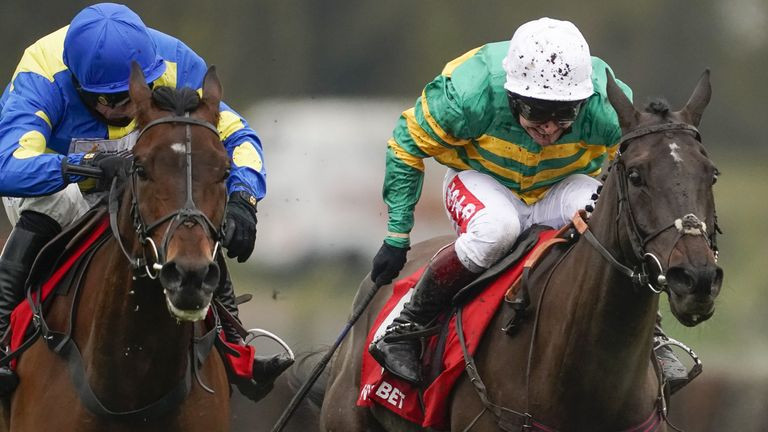 Sporting John ridden by Richard Johnson (right) wins the Scilly Isles