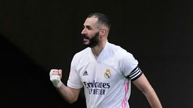 Karim Benzema scored a 13th La Liga goal of the season to keep Real Madrid in the title race against their city rivals