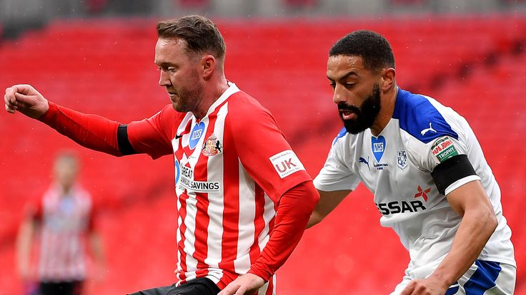 Aiden McGeady of Sunderland battles for possession with Liam Feeney of Tranmere Rovers during the Papa John's Trophy Final
