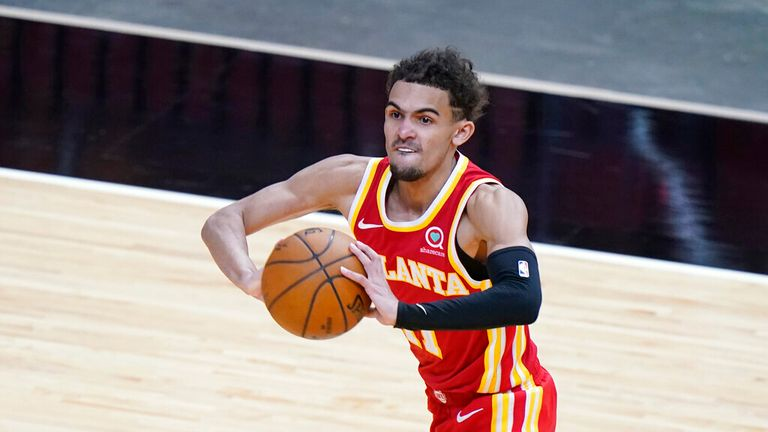 AP - Atlanta Hawks guard Trae Young passes the ball during the second half