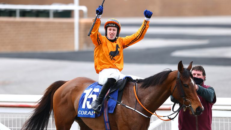 Richard Condon (jockey) celebrates on Heaven Help Us with the mare's trainer Paul Hennessy