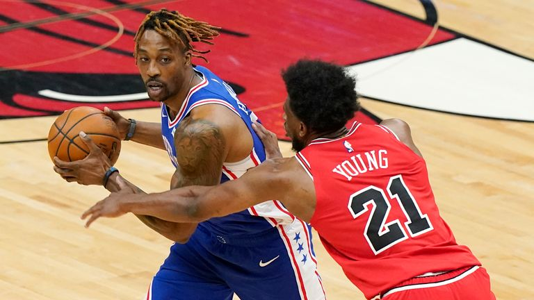 Philadelphia 76ers center Dwight Howard looks to pass the ball as Chicago Bulls forward Thaddeus Young defends