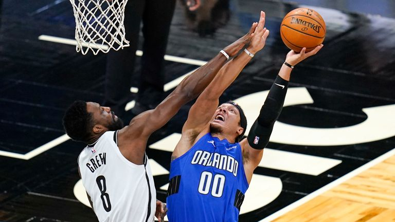 Brooklyn Nets forward Jeff Green fouls Orlando Magic forward Aaron Gordon as he goes up for a shot