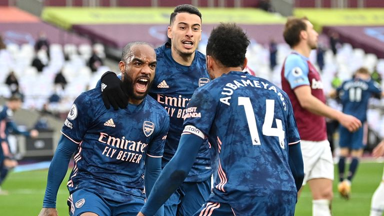 Arsenal's Alexandre Lacazette celebrates with Gabriel Martinelli and Pierre Emerick Aubameyang after scoring his third goal against West Ham