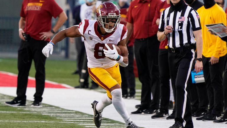 St Brown runs down the sideline for USC against Arizona during the 2020 season (AP Photo/Rick Scuteri)