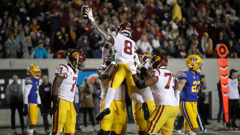 St Brown celebrates after scoring a touchdown against UCLA in November 2019 (AP Photo/Ben Margot)