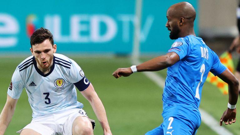 Scotland's Andy Robertson takes on Eli Dasa