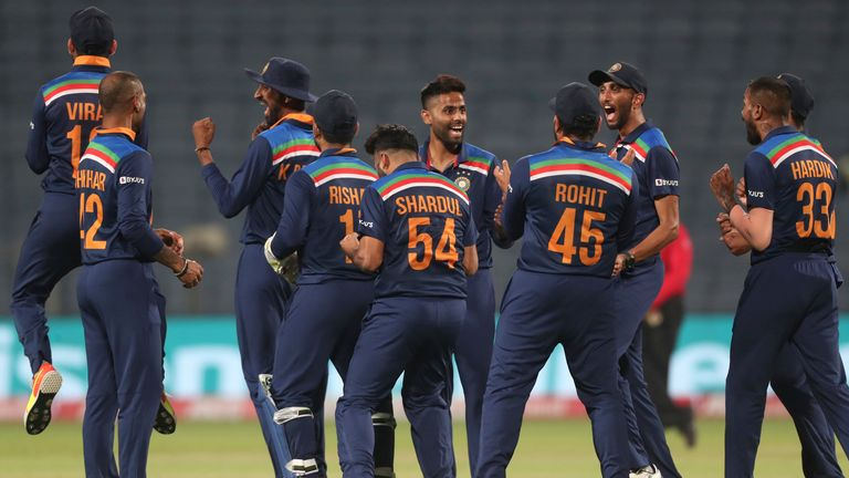 India celebrated wildly after a successful review saw Jos Buttler depart for 15