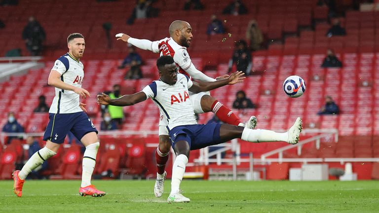 Davinson Sanchez gave away a penalty for this foul on Alexandre Lacazette