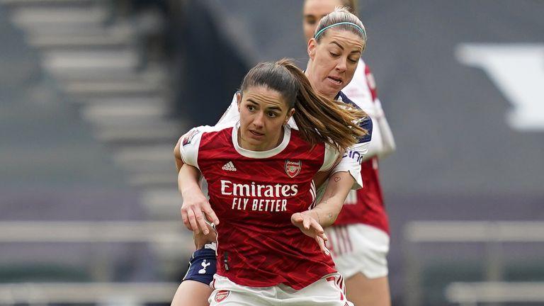 Arsenal's Danielle van de Donk (front) and Tottenham Hotspur's Alanna Kennedy battle for the ball