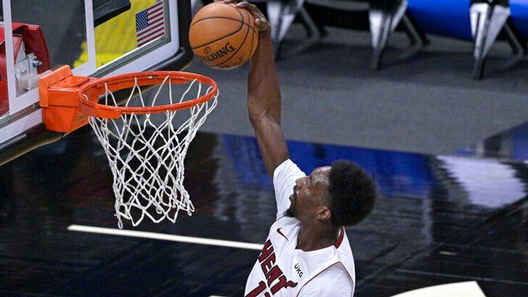 AP - Miami Heat forward Bam Adebayo (13) goes up for a dunk