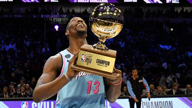 Miami Heat's Bam Adebayo holds the trophy after winning NBA basketball's All-Star Skills Challenge