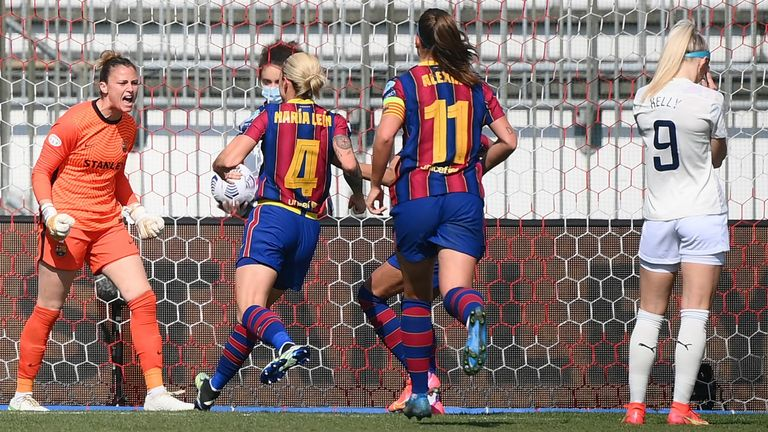 Barcelona goalkeeper Sandra Panos celebrates after saving a penalty shot by Man City's Chloe Kelly