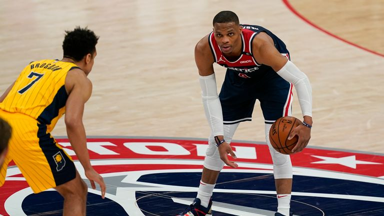 Russell Westbrook contributed 35 points, 22 assists and 14 rebounds as Washington overcame Indiana in Monday's NBA action.