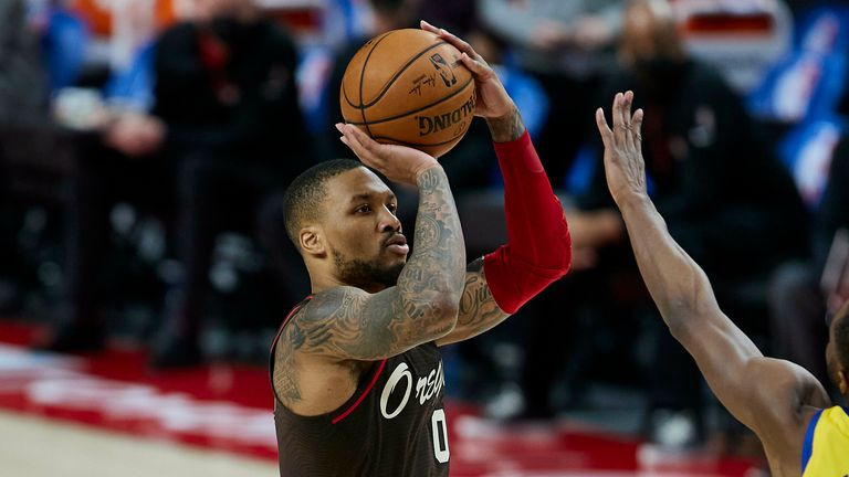 Portland Trail Blazers guard Damian Lillard shoots a 3-point basket against the Golden State Warriors