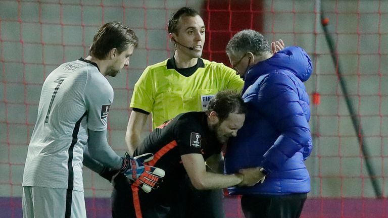 GETTY - Daley Blind is helped up by the Netherlands physio and goalkeeper Tim Krul after landing awkwardly on his ankle in the win over Gibraltar