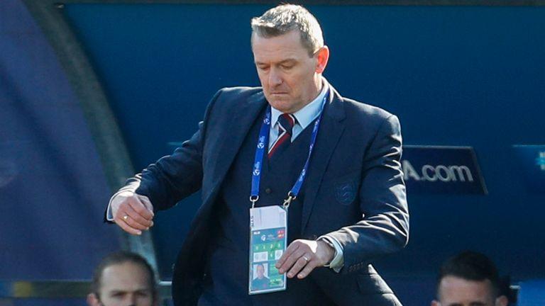 England coach Aidy Boothroyd kicks the ball during the Euro U21 group D soccer match between England and Switzerland in Koper, Slovenia, Thursday, March 25, 2021. (AP Photo/Darko Bandic)