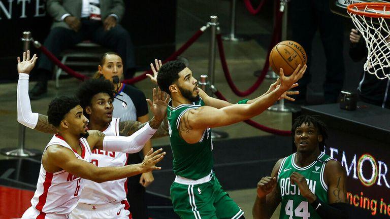 AP - Boston Celtics forward Jayson Tatum (0) scores a basket during the first quarter
