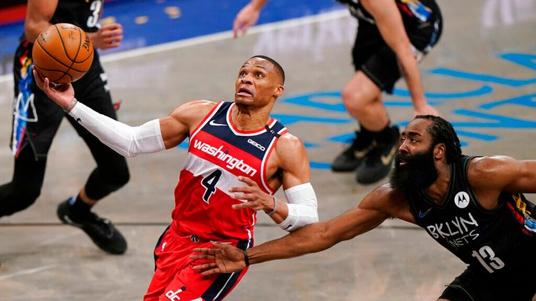 AP - Brooklyn Nets guard James Harden (13) tries to stop Washington Wizards guard Russell Westbrook (4) as Westbrook drives to the basket