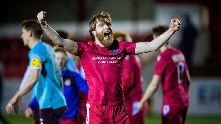 Brora's Dale Gillespie celebrates his sides win at full time
