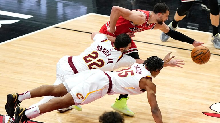 Chicago Bulls guard Zach LaVine battles for a loose ball against Cleveland Cavaliers forwards Larry Nance Jr. and Isaac Okoro