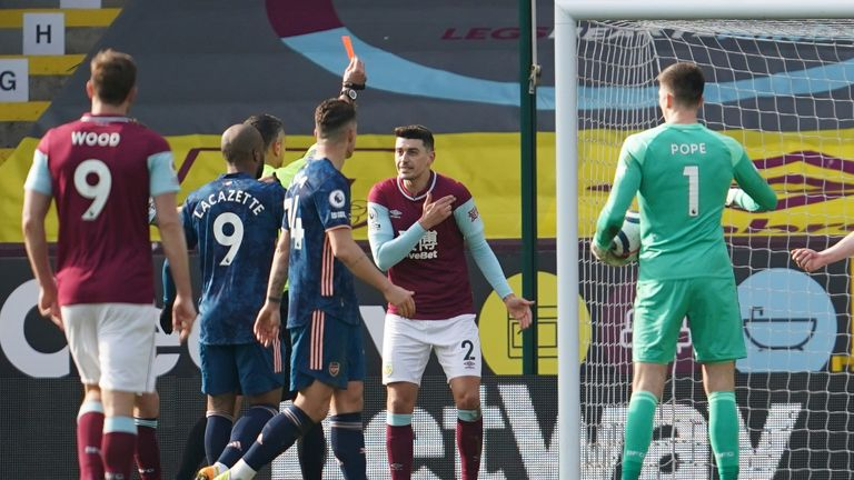 Burnley's Matthew Lowton protests the red card which was given to Erik Pieters before the decision was recinded