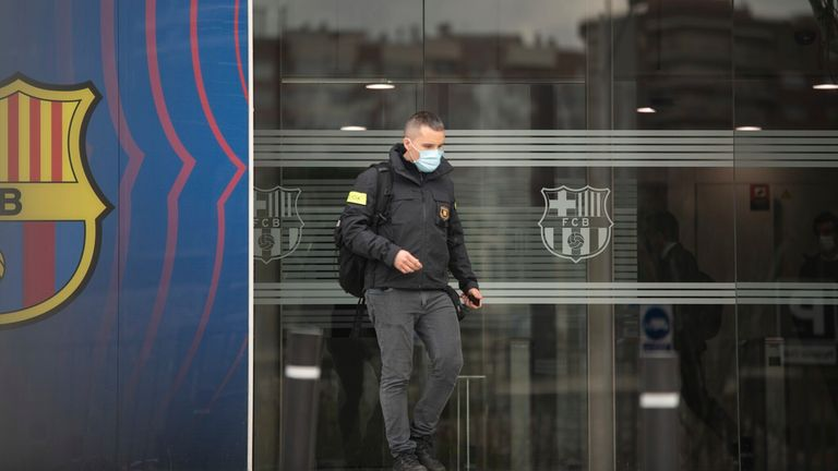 Catalan police leave the Nou Camp offices after the raid on Monday