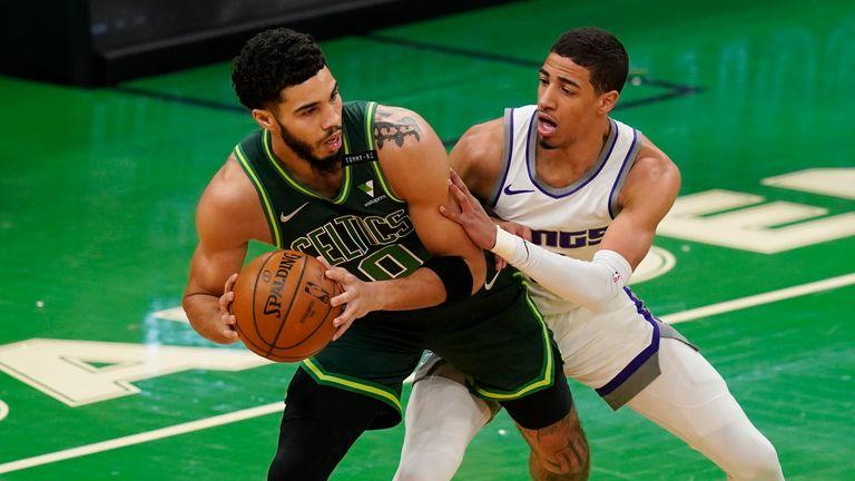 Boston Celtics forward Jayson Tatum makes a move against Sacramento Kings guard Tyrese Haliburton