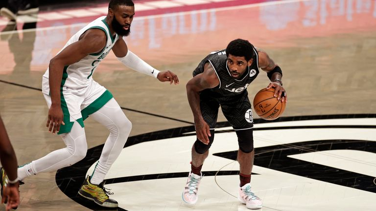 Brooklyn Nets guard Kyrie Irving (11) looks to pass the ball against the Boston Celtics
