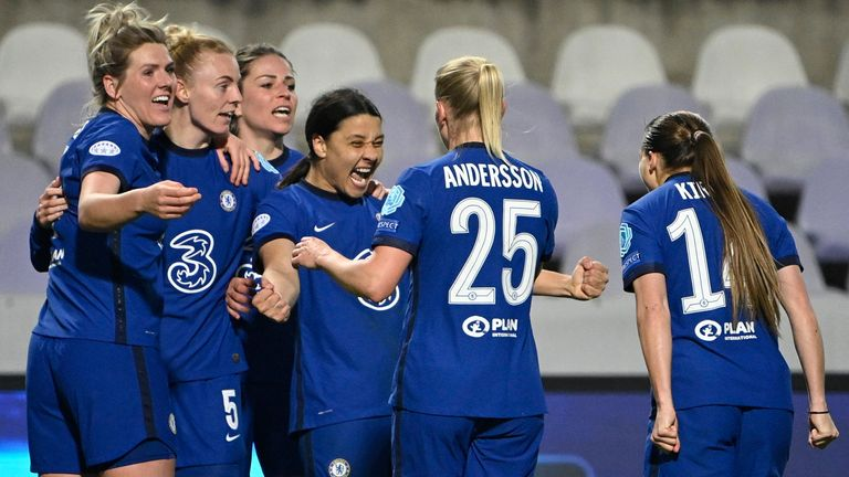 Players of Chelsea celebrate after a goal scored by Samantha Kerr, center, during the UEFA Women's Champions League quarter-final soccer match Chelsea vs Vfl Wolfsburg in the Ferenc Szusza Stadium in Budapest, Hungary, Wednesday, March 24, 2021. (Zsolt Szigetvary/MTI via AP)