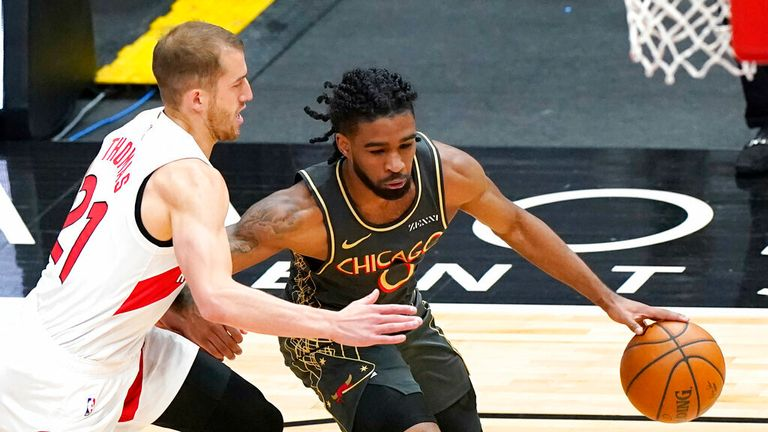 AP - Chicago Bulls guard Coby White, right, drives as Toronto Raptors guard Matt Thomas
