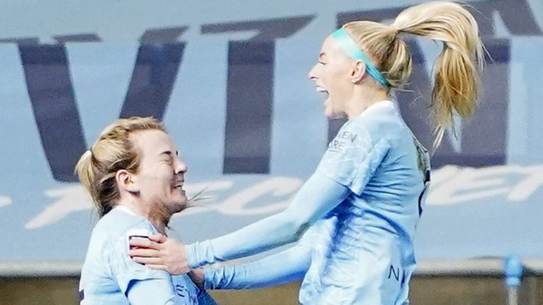 Manchester City forward Chloe Kelly (right) celebrates scoring the winning goal against Reading (PA)