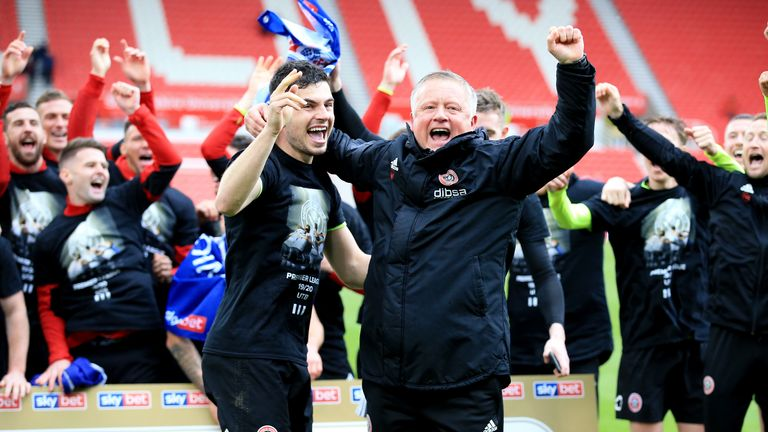 Chris Wilder and John Egan celebrate promotion to the Premier League at Stoke City on the final day of the 2018/19 Championship seasom