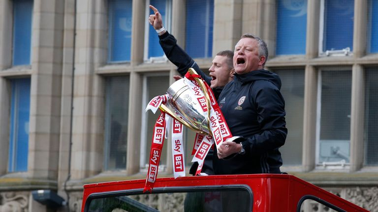 Chris Wilder with the League One trophy during an open top bus parade in 2017
