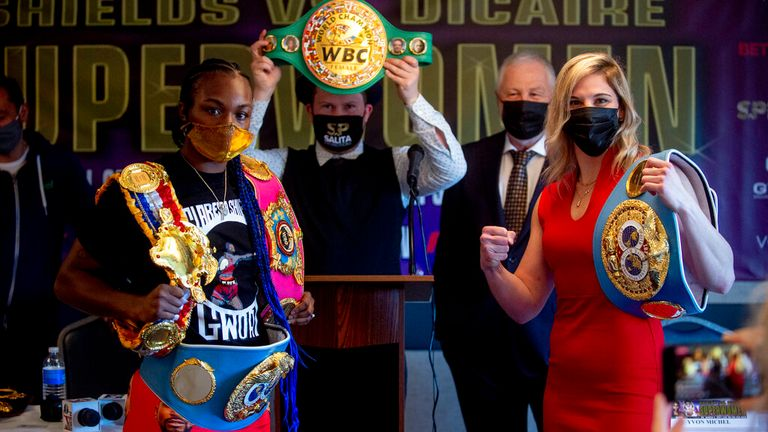 Claressa Shields (10-0-0, 2 KOs), left, will be fighting Marie Eve Dicaire (17-0-0, 0 KOs), right, for the women..s undisputed super welterweight world championship on March 5 at Dort Financial Center in Flint, pictured here facing off at a press conference on Wednesday, March 3, 2021. (Jake May | MLive.com) Jake May | MLive.com