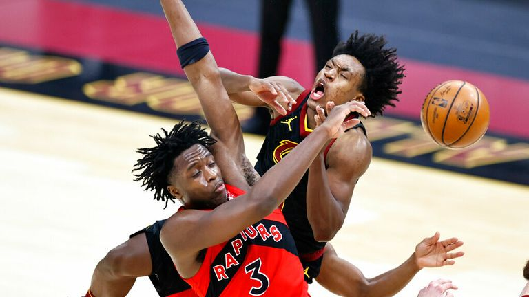 AP - Cleveland Cavaliers' Collin Sexton (2) and Toronto Raptors' OG Anunoby (3) battle for a loose ball