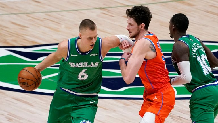 Dallas Mavericks center Kristaps Porzingis works around Oklahoma City Thunder center Mike Muscala